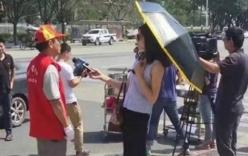 Đình chỉ phóng viên đeo kính râm, che ô khi tác nghiệp