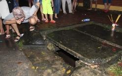 Bé trai 8 tuổi bị nước cuốn xuống cống trong mưa lớn