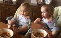 Bé gái tay không tập ăn bằng chân khiến triệu người xúc động