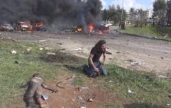 Phóng viên quỳ khóc nức nở bên thi thể em bé Syria trúng bom
