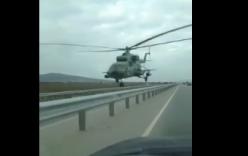 Video: Thót tim trực thăng Mi-8 Nga bay sát nóc ô tô trên cao tốc