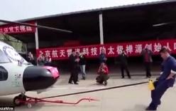 Võ sư Trung Quốc kéo trực thăng hạng nặng bằng