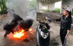 Khoe giàu có, cô gái mang xe máy ra đốt