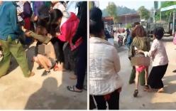 Vợ đánh bồ nhí của chồng dã man, lột quần áo giữa phố đông người