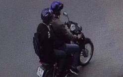 Hình ảnh 2 kẻ che kín mặt, ngồi trên xe máy nghi ném vật nổ vào trụ sở công an