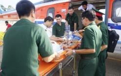 Trực thăng đưa hai ngư dân gặp nạn trên đảo Thuyền Chài về cấp cứu