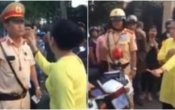 Chồng bị yêu cầu giữ xe, vợ chống tay chửi bới, xúc phạm CSGT