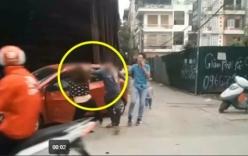 Chồng giật tóc, đánh vợ bầm dập từ trên ôtô xuống đất mặc con nhỏ đứng gào khóc