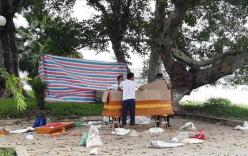 Thi thể người đàn ông buộc chặt vào tảng đá trôi trên sông Hương