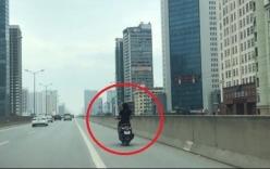 Cô gái đầu trần, phóng xe máy ở đường trên cao Phạm Hùng - Hà Nội