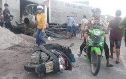 Xe tải vượt ẩu kéo lê xe máy khiến 2 người tử vong