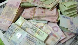 Đầu năm mới 2014 nhặt được túi tiền 10 triệu đồng