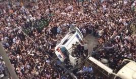 Hàng nghìn dân quây đánh gần chết 5 an ninh viên