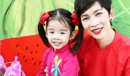 Con gái Xuân Lan diện áo dài chụp ảnh đáng yêu