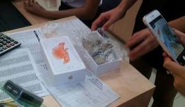 Video: Khách hàng mở hộp iPhone 6S Plus chứa toàn sỏi đá ở Yên Bái