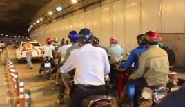 Cô gái lái ôtô gây náo loạn hầm vượt sông Sài Gòn