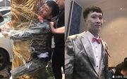 'Náo hôn lễ': Chú rể bị khách tham dự dùng băng dính trói vào cây, phun bình chữa cháy khắp người