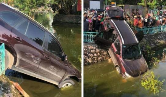 Tài xế phi qua dải phân cách, lao xuống hồ vẫn đòi nổ máy lùi xe