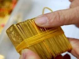 Hình ảnh Giao dịch mua vàng miếng có giá trị từ 300 triệu đồng trở lên phải báo cáo NHNN số 1