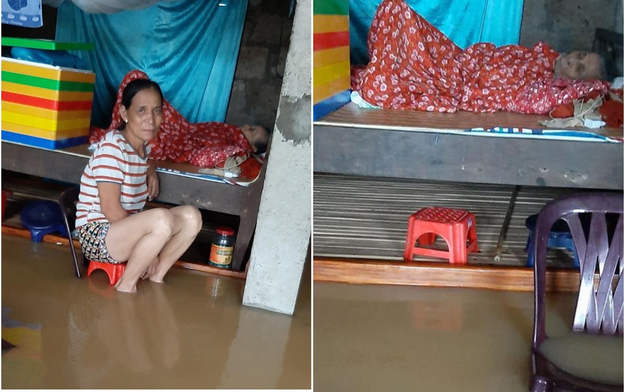 Hình ảnh cụ bà nằm trên giường trong khi nước lũ dâng cao khiến nhiều người xót xa 4