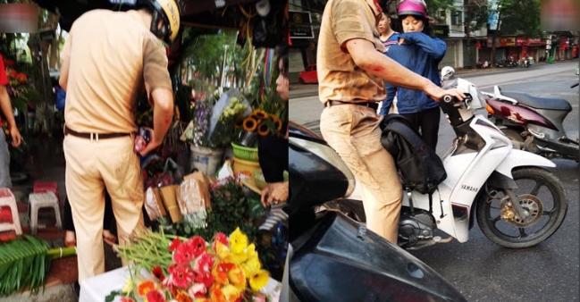 Hình ảnh đẹp: CSGT trầy xước sau va chạm xe máy với người phụ nữ và câu nói đáng giá 1